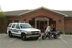 Patrol Unit and Motorcycle Outside of the Police Department